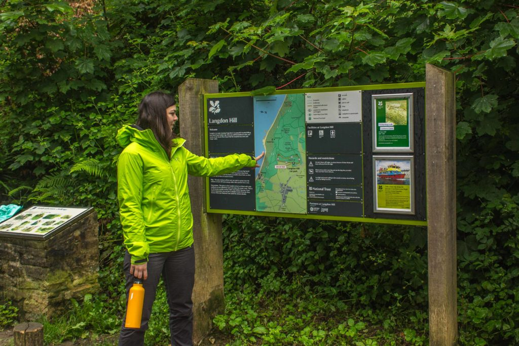 Sam pointing at the sign in the Langdon Hills car park