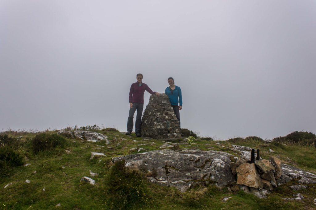 Jenna and Sam at the Moel-y-Gest trig pillar